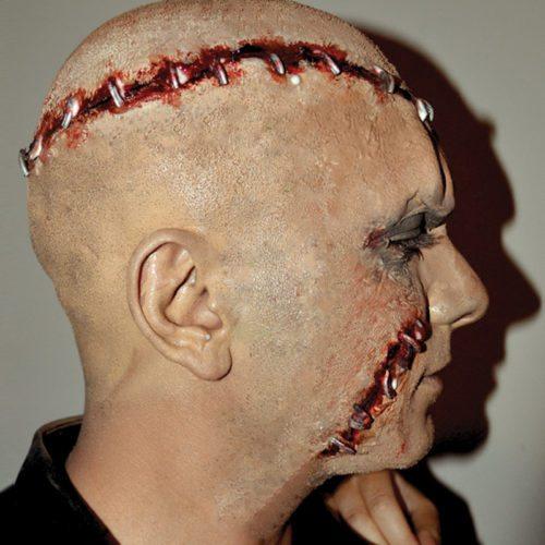 Special FX makeup stapled scalp wounds